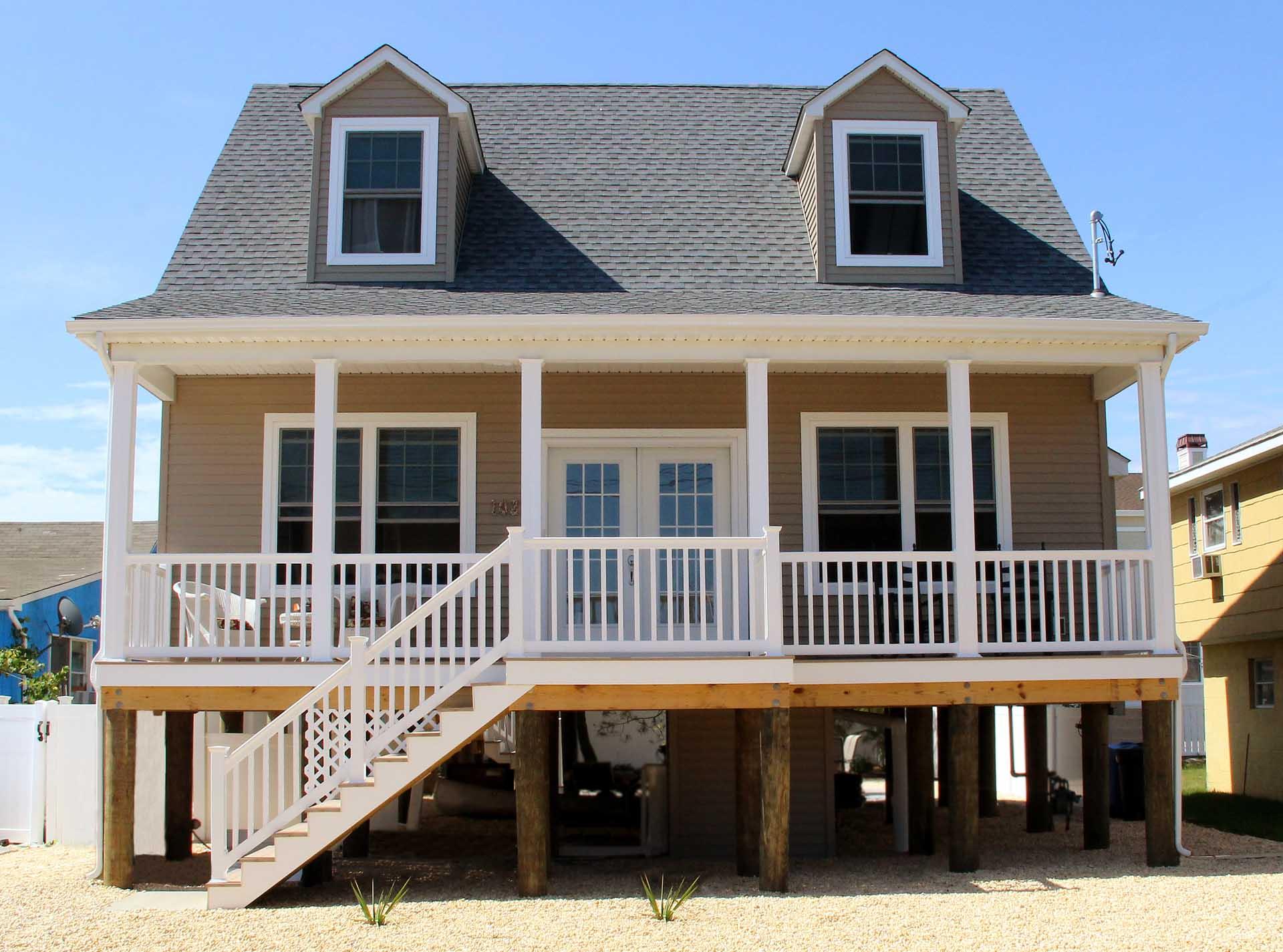 Modular beach style custom homes gallery zarrilli homes for Cape cod model homes