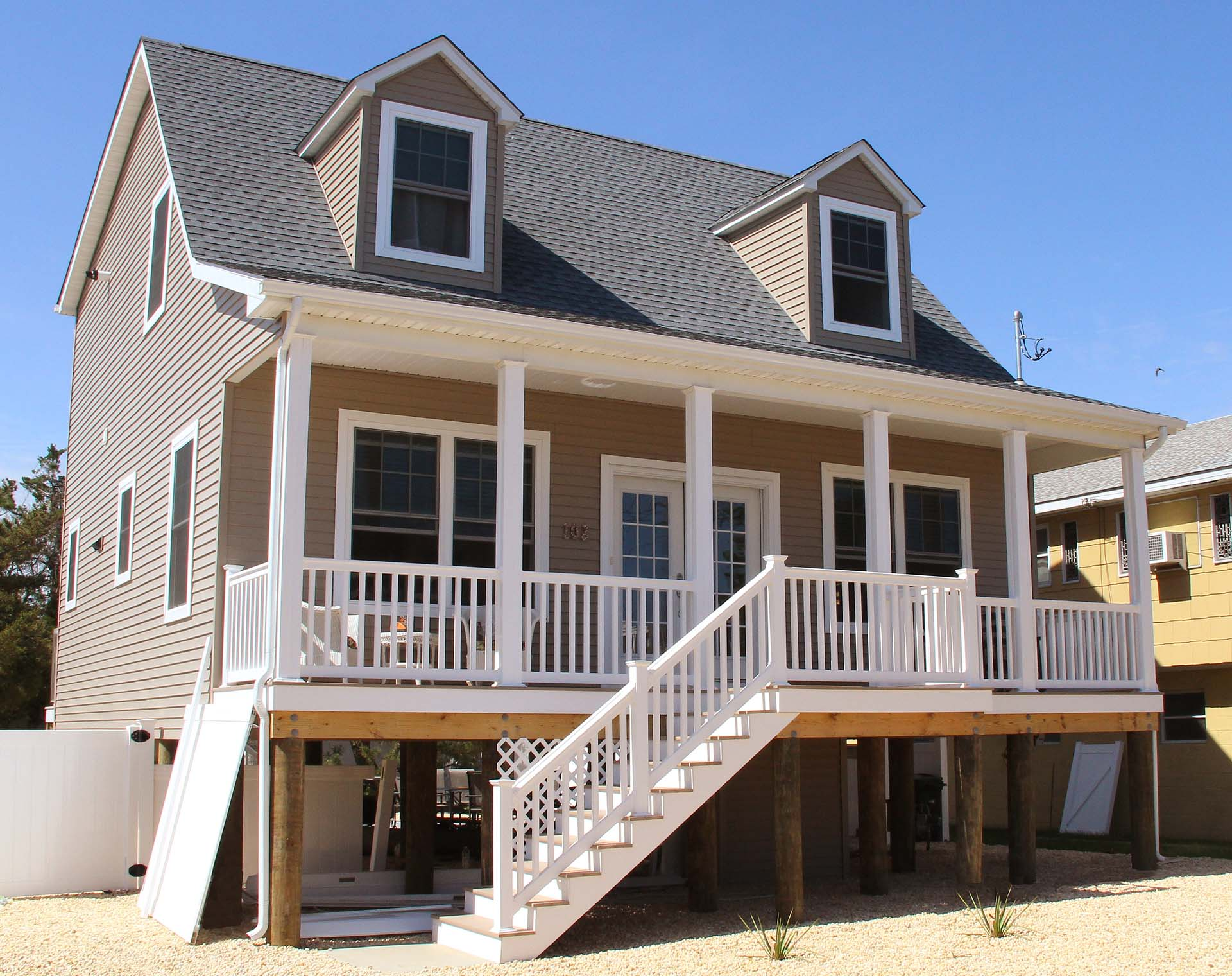 Modular beach style custom homes gallery zarrilli homes for Cape cod model homes